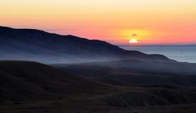 Sonnenaufgang auf Seeküste Lizenzfreie Stockfotografie
