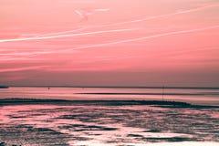 Sonnenaufgang bei Ebbe Stockbild