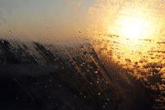 Sonnenaufgang durch das misted Glas Lizenzfreies Stockfoto