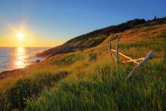 Sonnenaufgang durch den Ozean Stockfoto