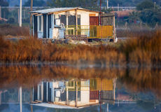 Sonnenaufgang-Haus-Reflexion Stockfotografie
