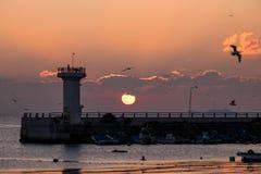 Sonnenaufgang, Leuchtturm, Dämmerung Lizenzfreie Stockfotos