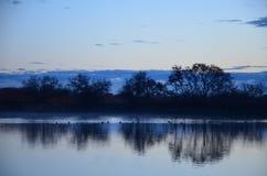 Sonnenaufgang-Reflexion Stockbild