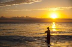 Sonnenaufgang und die Fischer Lizenzfreie Stockfotos