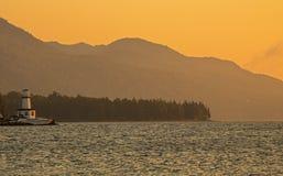 Sonnenaufgang und Leuchtturm über großem BH D ` oder auf Kap-Bretonisch, Nova Scotia stockbilder