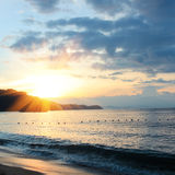 Sonnenaufgang und Strand Stockbild