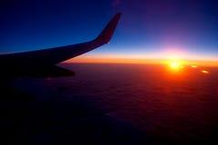 Sonnenaufgang vom Flugzeug Lizenzfreies Stockfoto