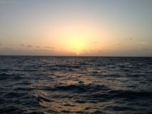 Sonnenaufgang von Caye-Kalfaterer Stockfotografie
