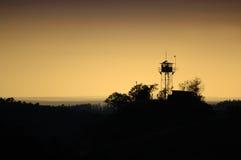 Sonnenaufgang-Wachstube lizenzfreie stockfotografie