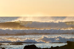 Sonnenaufgang-Wellen Stockfoto