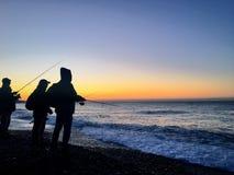 Sonnenaufgangangeln Mittelmeer Stockfotos