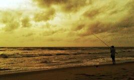 Sonnenaufgangfischer lizenzfreie stockbilder