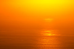 Sonnenaufgangglühen von Ozean Lizenzfreies Stockbild
