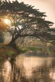 Sonnenaufgangreflexion in einem Kanal Lizenzfreie Stockbilder