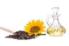 Sonnenblumenöl, mit Sonnenblume und Samen Lizenzfreie Stockbilder