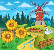 Sonnenblumen nähern sich Windmühle Stockbild