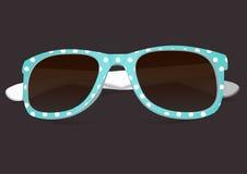 Sonnenbrille in der Farbkante Stockfotografie