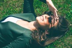 Sonnenbrillefrau Stockfoto