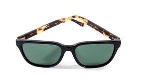 Sonnenbrillen auf weißem Hintergrund Stockfotografie