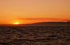 Sonnenscheins im Ozean Stockfotos