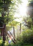 Sonnenstrahlen am Bauernhof Stockbild