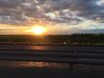 Sonnenuntergänge und Reisen Stockbild