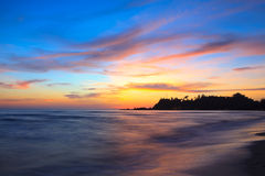 Sonnenuntergang über dem Meer Stockfotos
