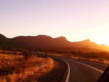 Sonnenuntergang über den Strecken Lizenzfreie Stockfotos