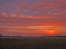 Sonnenuntergang über der Ebene stockfotografie