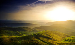 Sonnenuntergang über einem Tal Stockbild