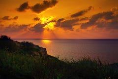 Sonnenuntergang über Meer Stockfotos