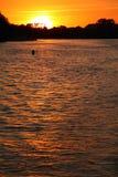 Sonnenuntergang über See Lizenzfreies Stockfoto