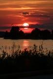 Sonnenuntergang über See Lizenzfreie Stockfotografie