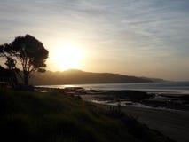 Sonnenuntergang über Strand Lizenzfreie Stockfotografie