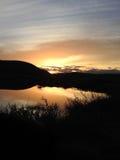 Sonnenuntergang über Teich Stockfoto