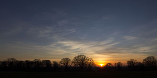 Sonnenuntergang über Warwickshire-Landschaft Stockfotografie