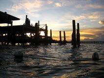 Sonnenuntergang-Anlegestelle Stockfotos