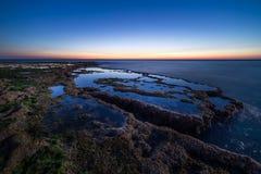 Sonnenuntergang auf Achziv-Strand Stockbild