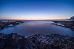 Sonnenuntergang auf Achziv-Strand Lizenzfreies Stockfoto