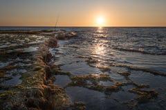Sonnenuntergang auf Achziv-Strand Stockbilder
