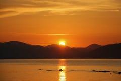 Sonnenuntergang auf dem Meer Stockfotos