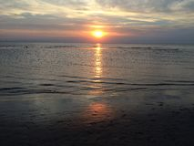 Sonnenuntergang auf dem Strand Lizenzfreie Stockbilder
