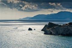 Sonnenuntergang auf dem Strand von Agios Minas in Karpathos-Insel in Griechenland Stockfotografie