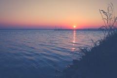 Sonnenuntergang auf der Bucht des Kobolds Lizenzfreies Stockfoto