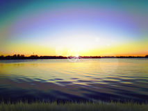 Sonnenuntergang auf See Stockbild