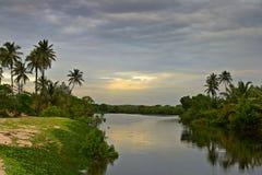 Sonnenuntergang auf Stauwassern Lizenzfreies Stockfoto