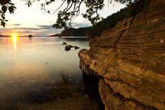 Sonnenuntergang auf Strand Stockfotos