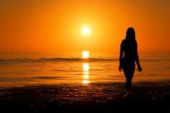 Sonnenuntergang auf te Strand Stockfotos