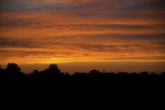 Sonnenuntergang-Bauernhof Stockbilder