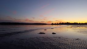 Sonnenuntergang bei Ebbe Lizenzfreie Stockbilder